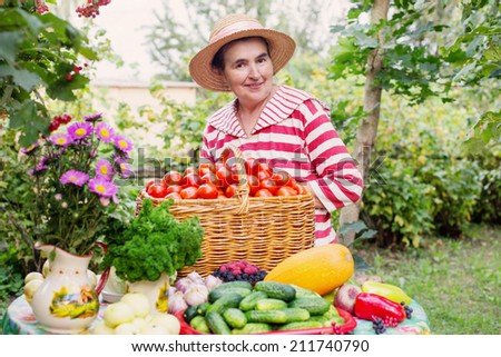happy elderly women with vegetables outdoor