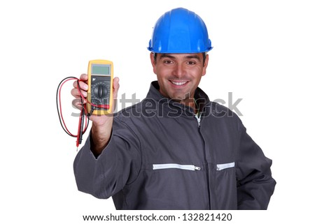happy electrician showing multimeter - stock photo