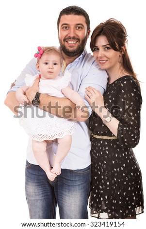 Happy elegant family with baby girl isolated on white background - stock photo