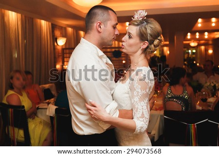 happy elegant  gorgeous married couple dancing in a restaurant, celebrating wedding - stock photo