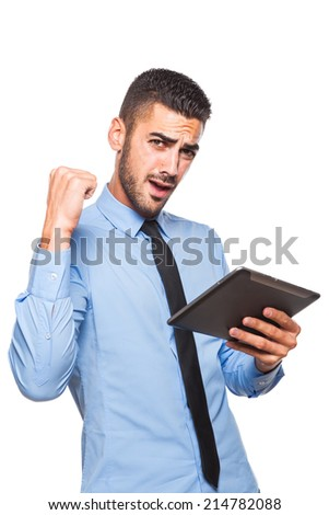 happy elegant handsome man using a tablet and showing winning sign