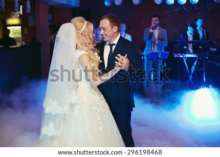 happy elegant married couple dancing  in a restaurant, celebrating wedding - stock photo