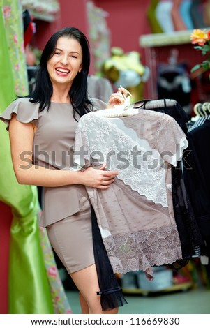 happy elegant woman shopping in clothing store