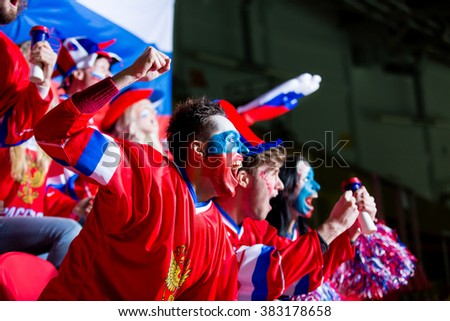 Happy emotional fans in stadium - stock photo