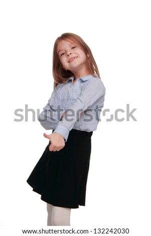 Happy emotional little girl in modern school uniform and healthy long hair dancing and having fun on Education - stock photo