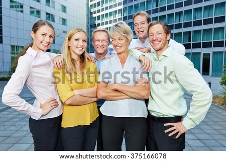 Happy employees and smiling staff members as a successful business team