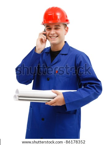 Happy engineer with red helmet holding layout plans talking on the phone - stock photo