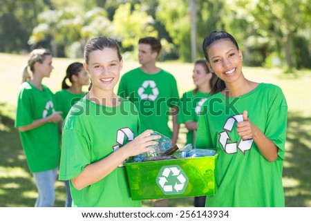 Happy environmental activists in the park on a sunny day - stock photo