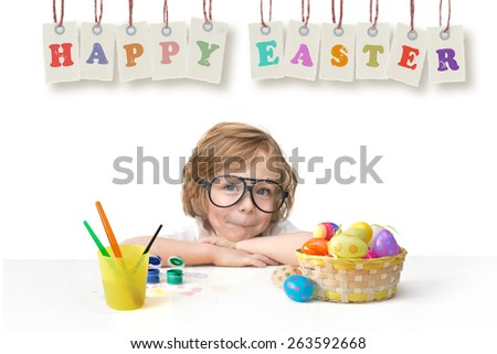 Happy ester greetings. Cute little boy with toy glasses painting easter eggs happy easter banner isolated on white background.