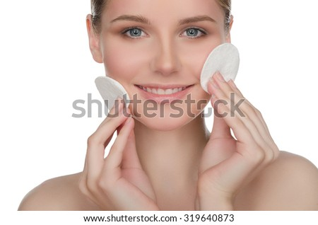 happy European woman with cotton pad, isolated on white