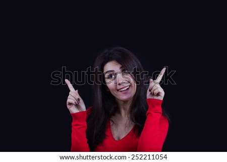 Happy excited energetic woman pointing up.Portrait of cheering beautiful young women.Facial expression. - stock photo