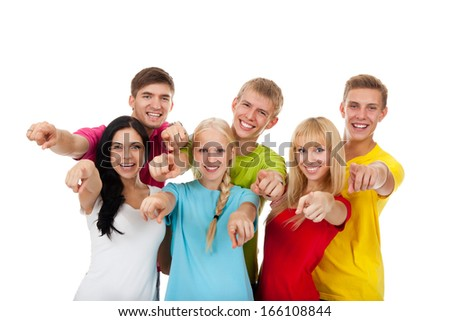 Happy excited smiling friends, group of young people students standing point finger at you together isolated on white background - stock photo