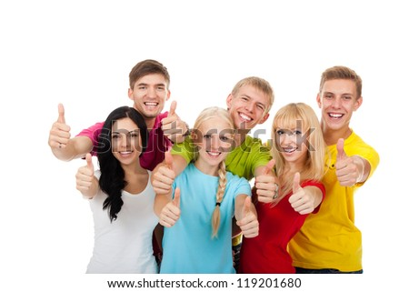 Happy excited smiling friends holding thumb up gesture, group of young people students standing point finger hands at you together isolated on white background