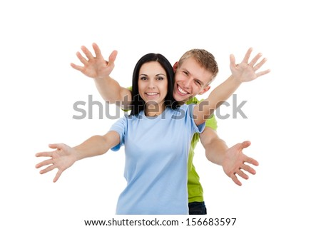 Happy excited smiling friends man and woman holding open palm at you, young people students girl and guy show welcome freedom gesture isolated on white background
