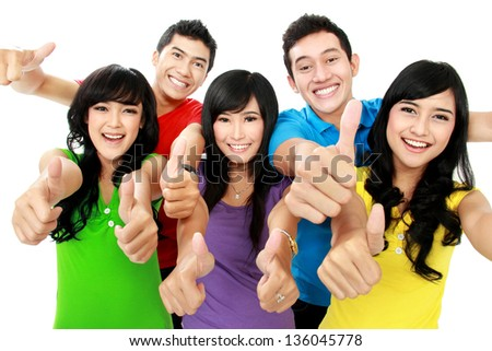 Happy excited smiling friends showing thumb up gesture - stock photo