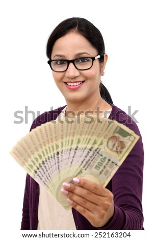 Happy excited successful young woman holding Indian rupee bills - stock photo