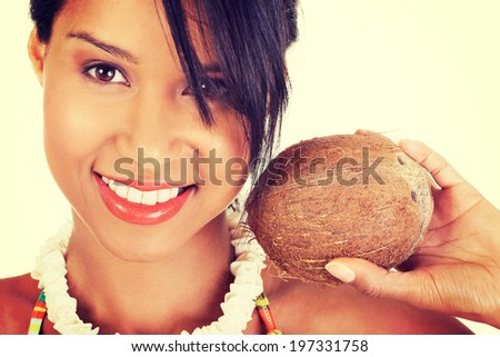 Happy excited summer woman with coconut. - stock photo
