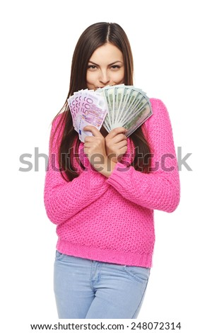 Happy excited woman holding us dollar money in one hand and euro cash money in another hand, over white background - stock photo