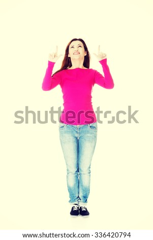 Happy , excited woman pointing on copy space. - stock photo