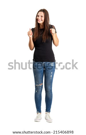 Happy excited woman with clenched fists. Full body length isolated over white. - stock photo