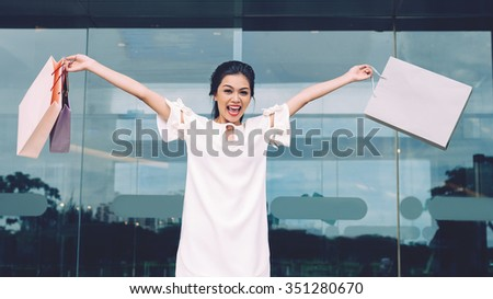 Happy excited woman with shopping bags
