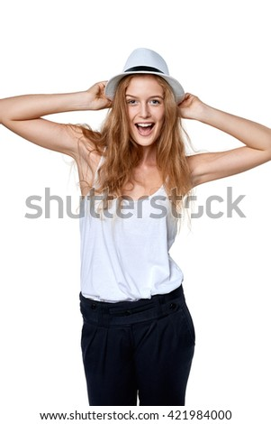 Happy excited woman with straw hat laughing at camera