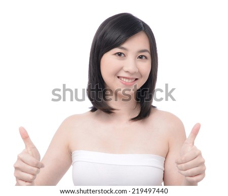 Happy excited young woman gives a thumbs up gesture - stock photo