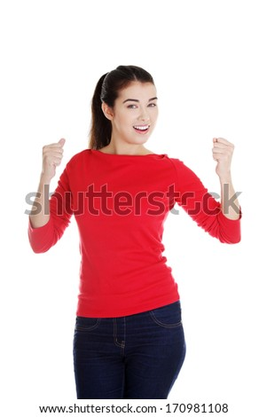 Happy ,excited young woman with fists up
