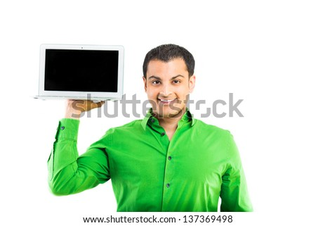 Happy executive  displaying a laptop on white background - stock photo