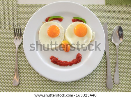 Happy Face Frying Eggs breakfast. - stock photo