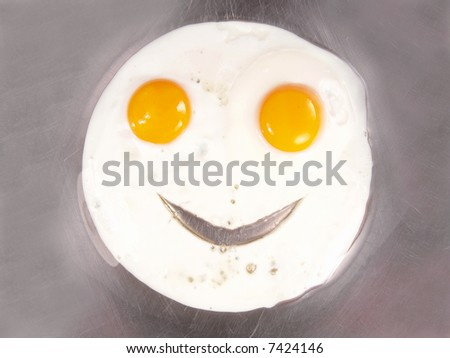 Happy Face Frying Eggs Sunny Side Up Close-up - stock photo