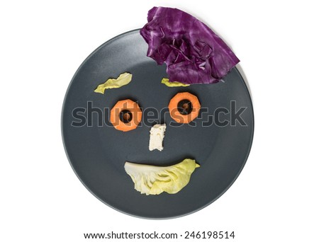 Happy face with vegetables on grey plate isolated on white background - stock photo
