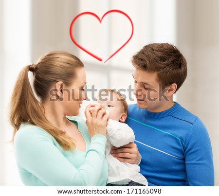 happy family and adorable baby with feeding-bottle - stock photo
