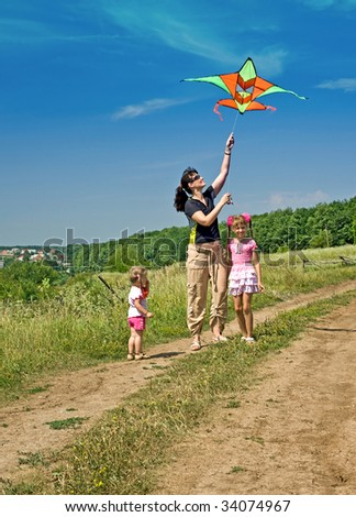Happy family and children fly kite. Outdoor. - stock photo