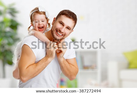 happy family and father's day. child daughter  hugging dad and playing - stock photo