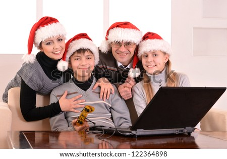 happy family at a laptop in the room - stock photo