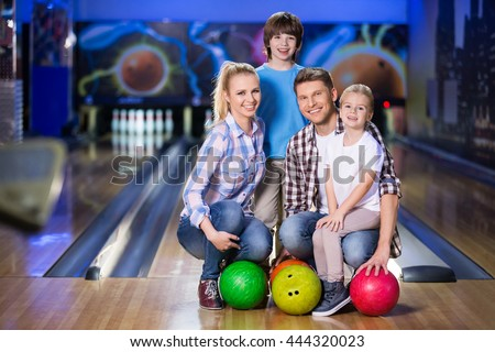 Happy family at bowling