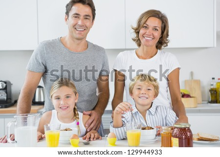 Happy family at breakfast in kitchen