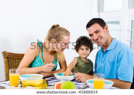happy family at breakfast table - stock photo