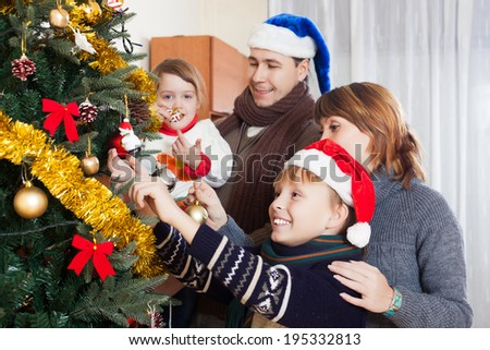Happy family at Christmas time or winter holiday season