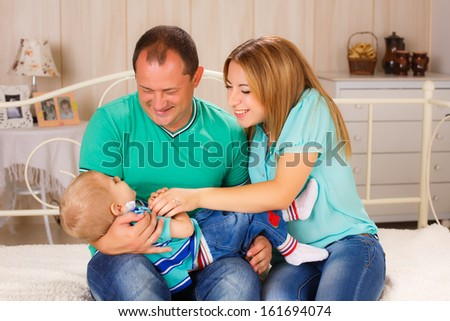 happy family at home. Play with your child - stock photo