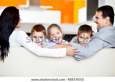 Happy family at home spending time together - stock photo