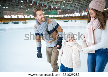 Happy family at skating rink