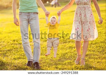 Happy family at sunset - stock photo