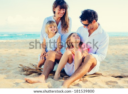 Happy Family at the Beach, Quality Family Time, Lifestyle Concept - stock photo
