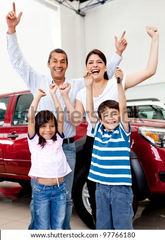 Happy family at the dealership buying a new car - stock photo