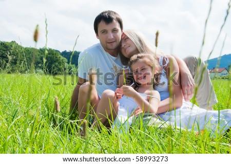 happy family at the park - stock photo