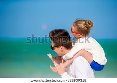 Happy family at white beach having fun - stock photo