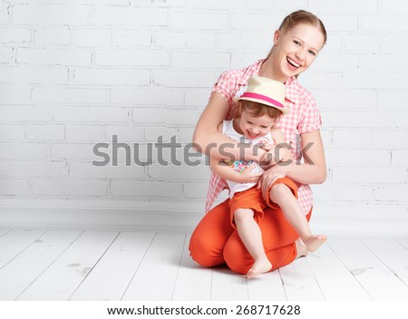 happy family  baby daughter and mother laughing, smiling, playing - stock photo