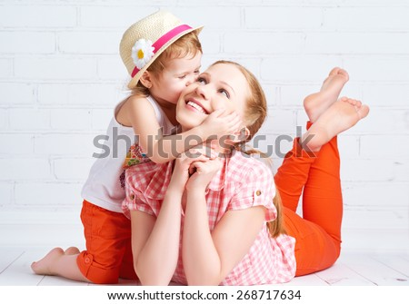 happy family baby daughter kissing mother - stock photo